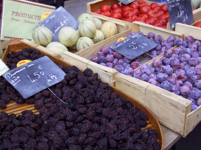 prunes in a market in issegiac, france
