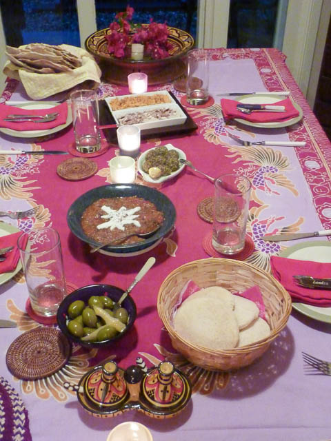 Middle Eastern Mezze plates with olives, dips and breads