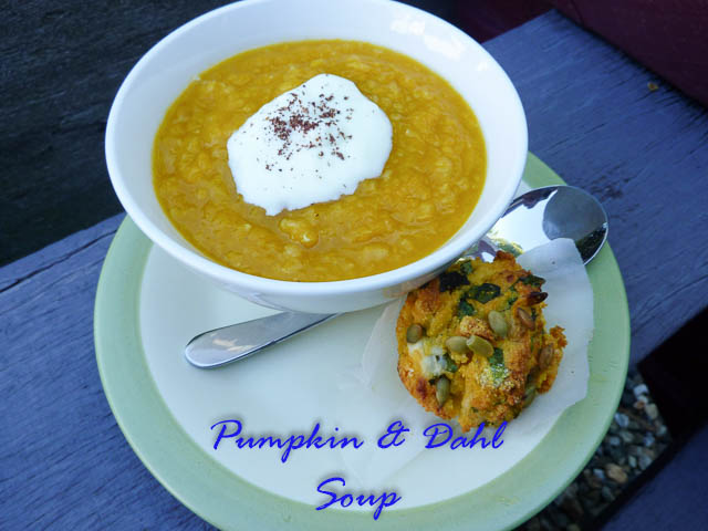 Bowl of pumpkin & dahl soup, topped with natural yoghurt and a pumpkin muffin as a side
