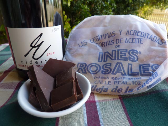 Ingredients for iced chocolate wine including wine, chocolate and biscuits to serev