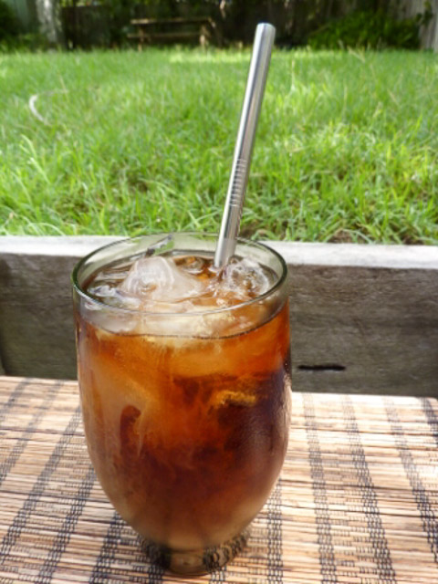 steel straw in a glass of iced coffee