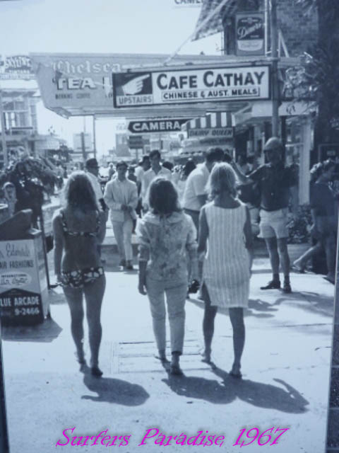 Women walking down Cavill Ave in bikinis at Surfers Paradise, Queensland. 1967.