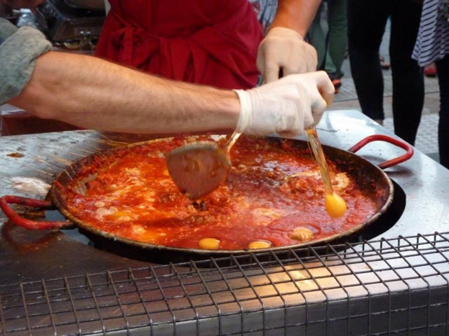 Shakshuka...see the egg being broken into the sauce?