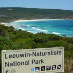sign in front of the ocean for leeuwin-naturaliste national park in western australia