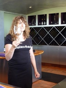 a woman demonstrating wine tasting