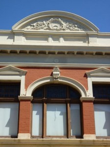 Historic Fremantle building in red brick and ochre paint - decorative arch 1