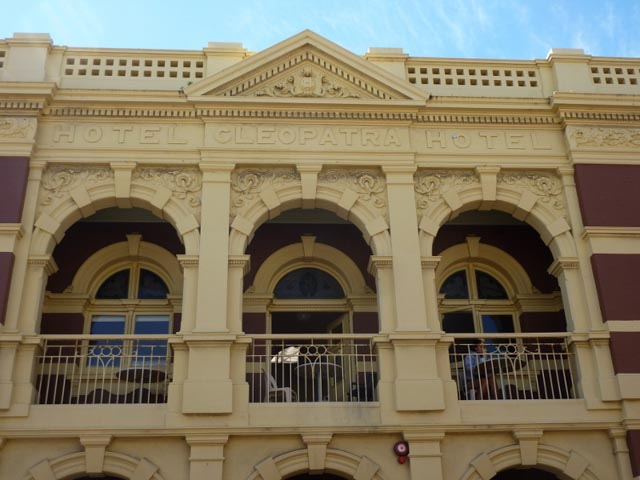 Historic Hotel Cleopatra building in red brick and ochre paint - Fremantle, WA