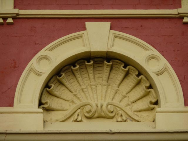 Historic building, closeup of shell detail in ochre & red brick - Fremantle, WA