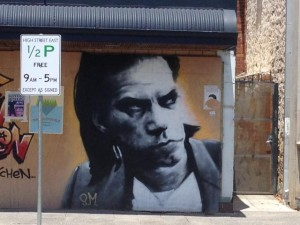 Street art - picture of musician Nic Cave spary painted onto a wall in Fremantle