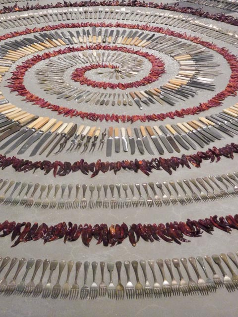 Painting at the Qld Gallery of Modern Art: 'Forking Tongues' Gill 1992 with spirals of Dried Chillis & Cutlery on a cement floor