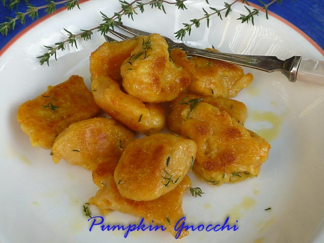 Pumpkin & Ricotta Gnocchi in a bowl with thyme and brown butter sauce