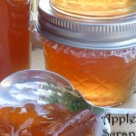 Jars of apple scrap jelly made from food scraps with a scoop of the jelly in a spoon