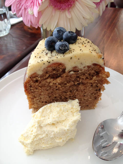 Chai spiced cake with cream cheese icing topped with blueberries