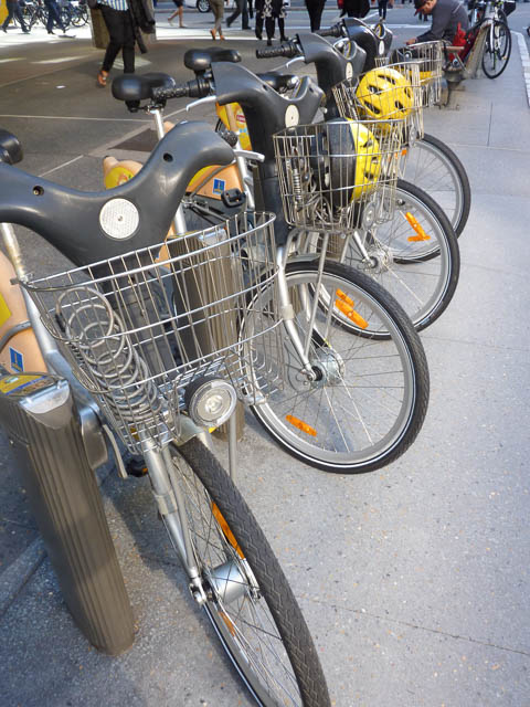 Brisbane City Cycles docked in their stations, awaiting rental