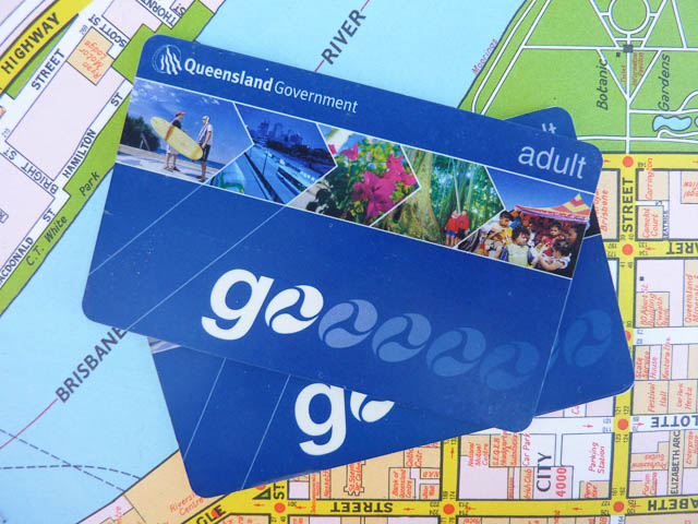 Two Brisbane public transport Go Cards resting on a map of Brisbane