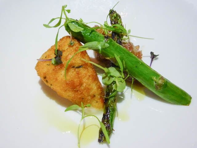 Two spears of Charred Asparagus & Crumbed Buffalo Mozzarella with a light dressing.