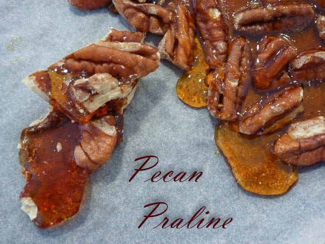Pecan nuts in toffee on a tray.