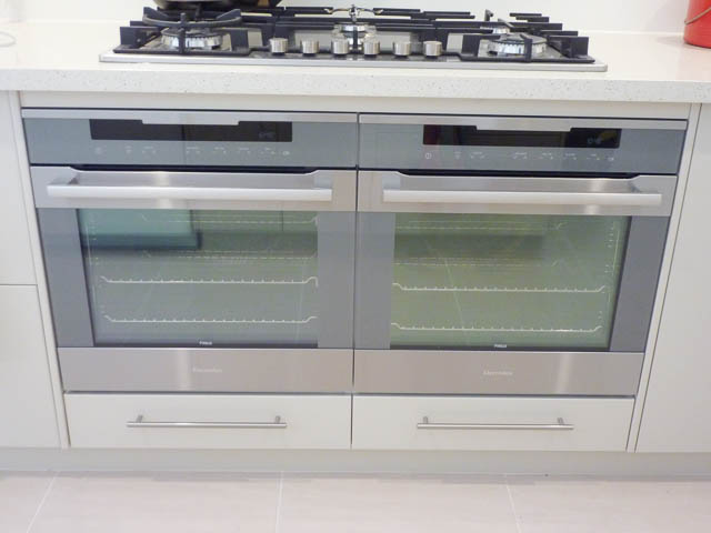 Two modern ovens side by side in a kitchen