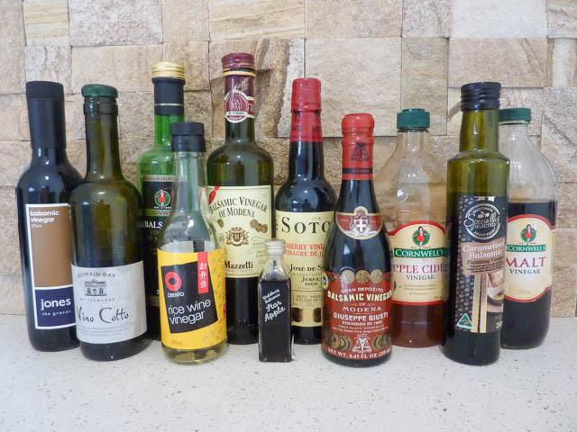 11 vinegar bottles sitting on a shelf