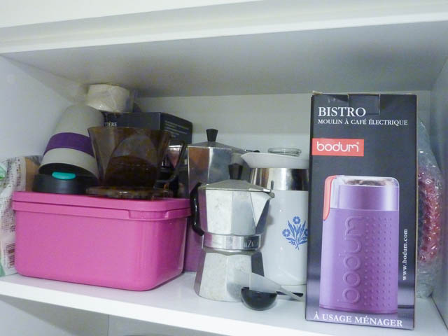 A shelf with coffee pots, plungers, filters and grinders