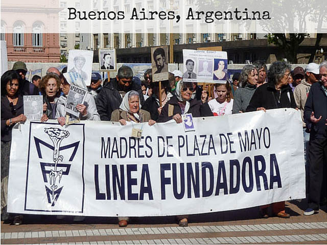 The Madres de Plaza de Mayo women marching behind a protest banner in Plaza De Mayo, Buenos Aires Argentina