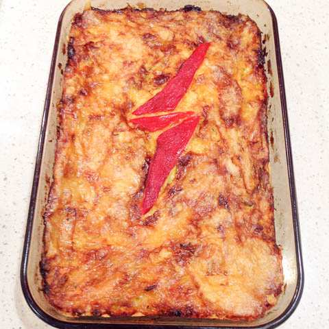 Tray bake of zucchini slice with Ziggy Stardust lightning bolt of red capsicum