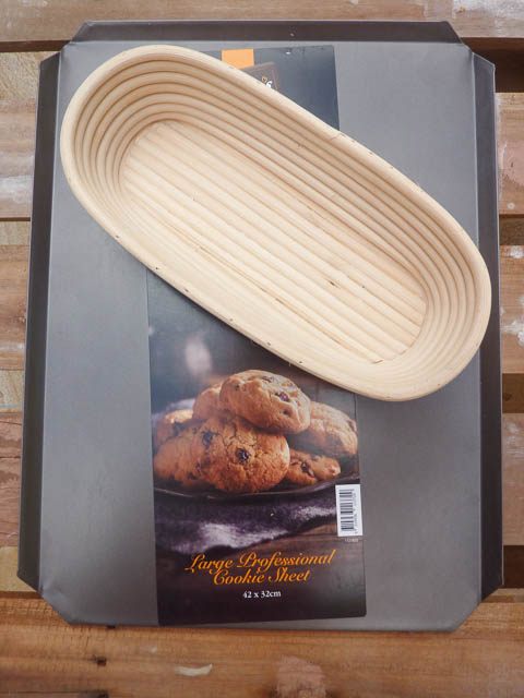 Baking eqipment - a large cookie tray and a banneton basket for proving bread