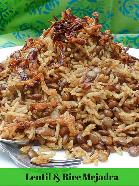 A plate is piled high with Mejadra. A dish of rice, lentils and crisply fried onions
