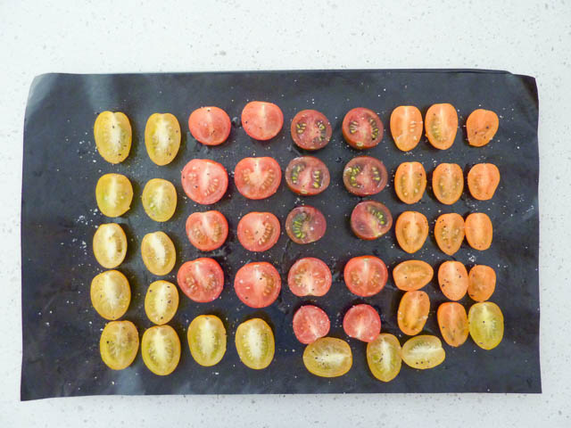 A tray of sliced cherry and egg tomatoes