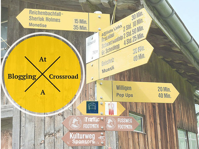 Footpath signs in Switzerland pointing in various directions to various sights
