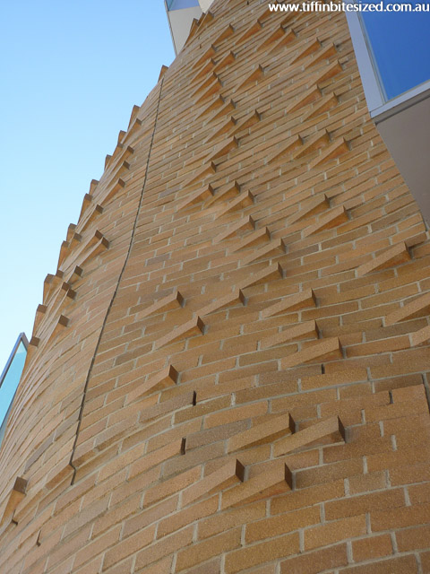 Closeup of bricks on Frank Ghery's curved and folded building at UTS, Sydney