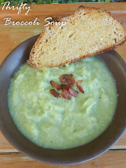 A bowl of chunky broccoli soup with toast