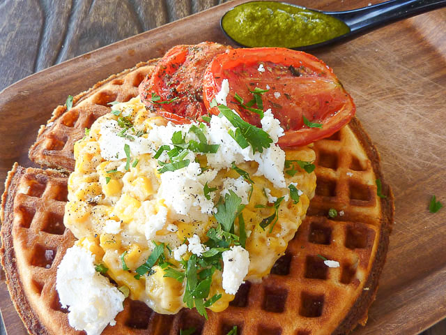 Corn waffles with feta, roasted tomatoes and chimichurri sauce