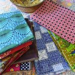 Lengths of colourfully printed fabric from Kenya, Indonesia, Tanzania and Fiji