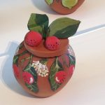 Pottery bowl decorated with painted pottery bloodwood apples. From the Hermannsburg Potters Bush Tucker series - QAGOMA