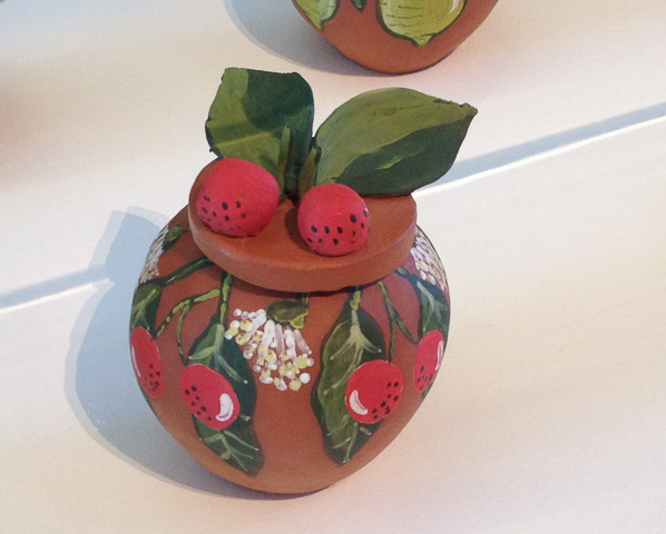 Pottery bowl decorated with painted pottery bloodwood apples. From the Hermannsburg Potters Bush Tucker series - QAGOMA. For NAIDOC Week