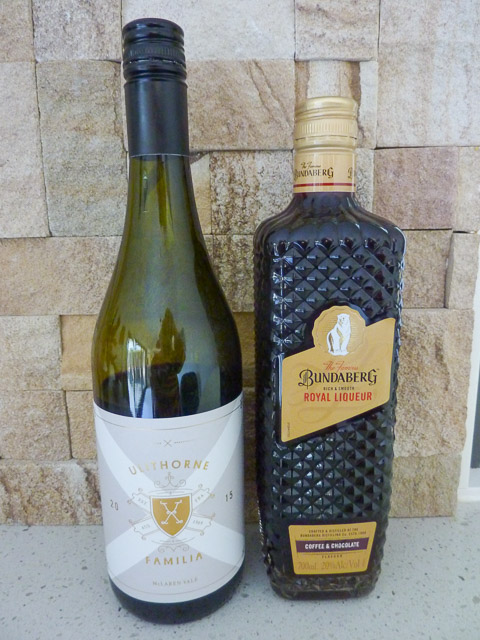 a bottle of wine and a bottle of bundaberg rum