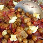 Dish of Cretan Dakos with bread, chickpeas, tomatoes and feta cheese