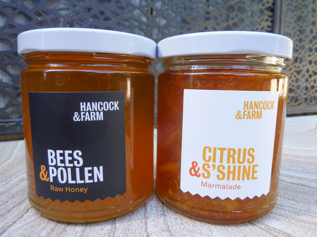 a jar of honey and a jar of marmalade