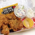Pieces of NeNe Chicken in a lunch box with accompaniments