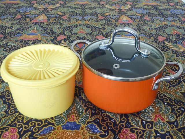 From a Gympie op shop: small yellow Tupperware servalier cannister with sunburst lid and burnt orange Baccarat saucepan with matching glass lid
