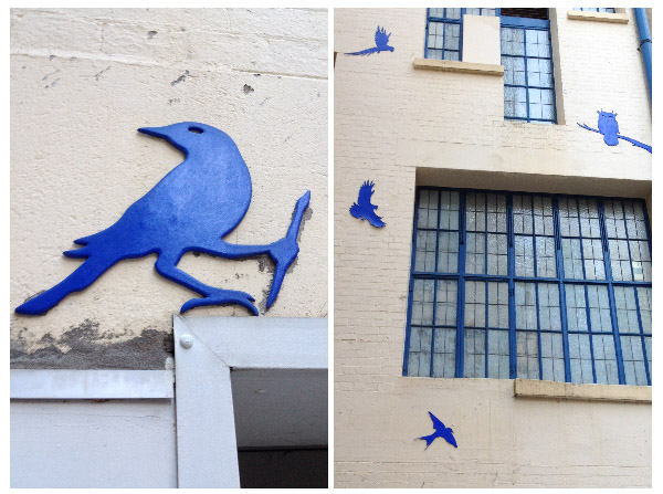 blue birds placed on the walls of a laneway by blu art xinja