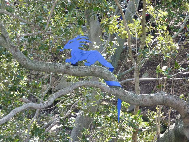 a blue dragon sits in a tree - placed there by blu art xinja
