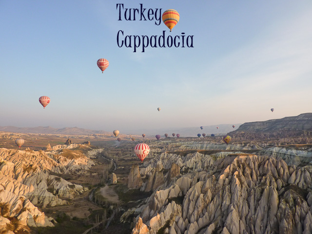 Cappadocia Balloons fly over the fairy chimneys of Cappadocia, Turkey
