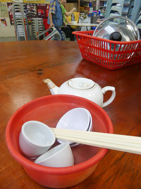 bowl of dishes, chopsticks and cup at sheung wan cooked food centre, hong kong