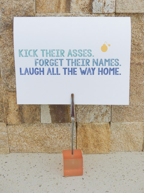 card showing 'kick their asses' motto