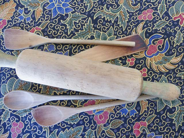 four wooden spoons and a rolling pin