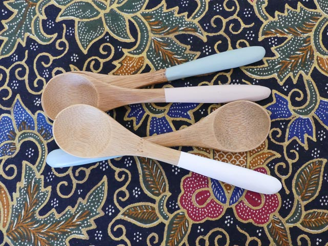 four small bamboo teaspoons with pastel coloured handles
