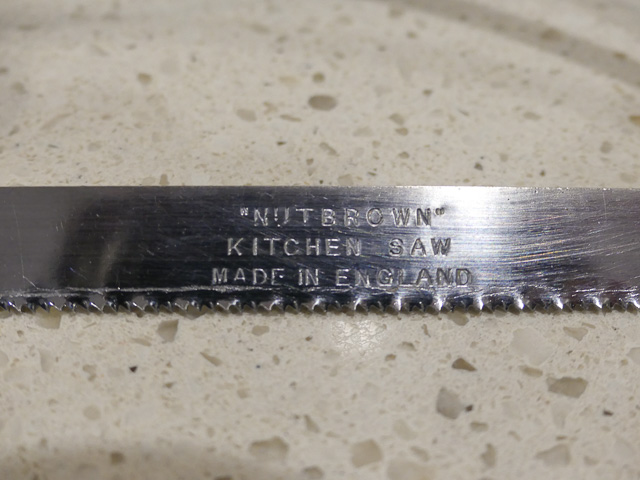 nutbrown maker's mark on a bone saw