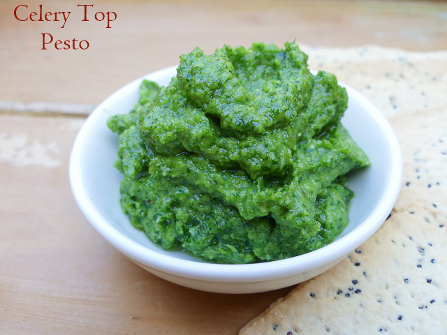 dish of celery top pesto and crackers
